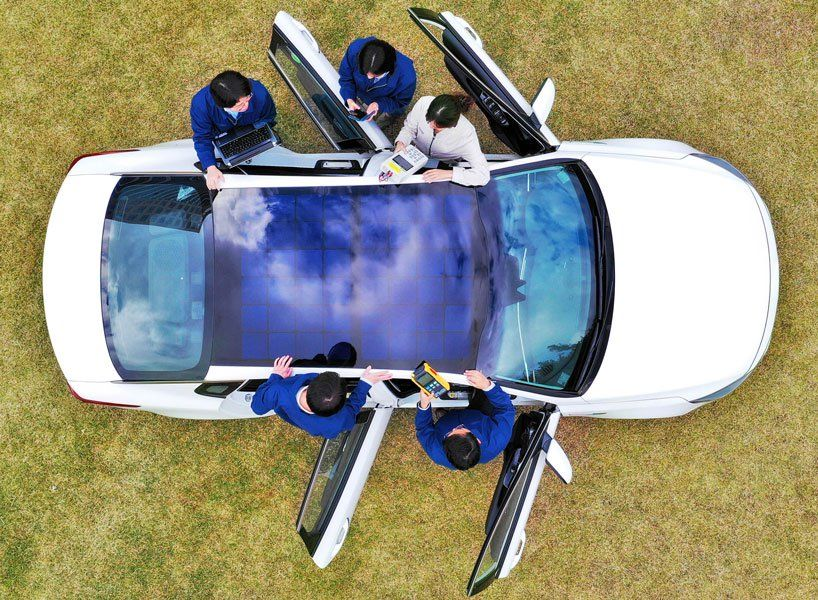 Hyundai And Kia Unveil Panoramic Solar Roof To Boost Batteries In Vehicles The Electricity Generating Solar Panels Will Solar Car Solar Panels Roof Solar Roof