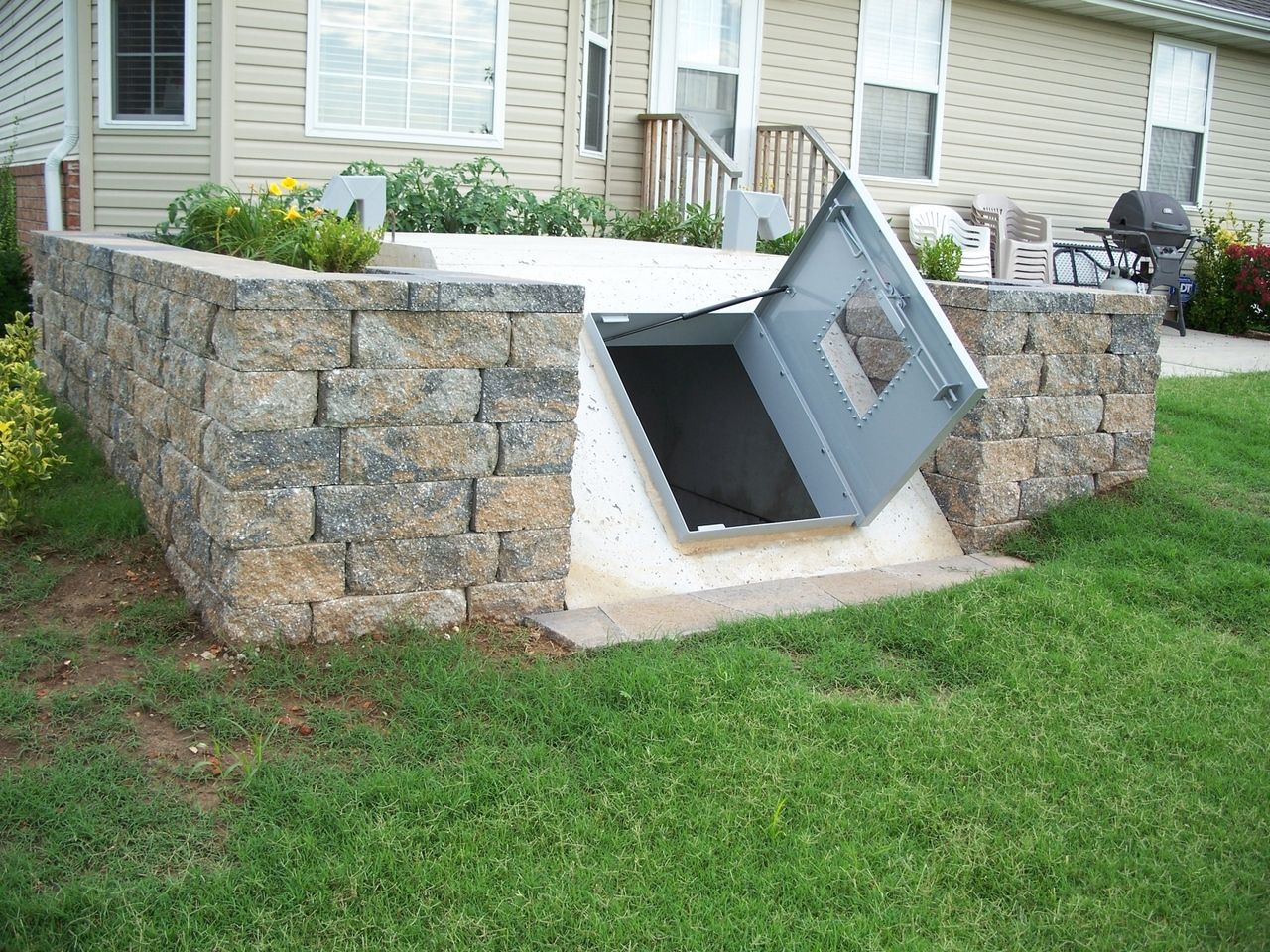 Underground storm tornado shelter in landscaping storage root cellar play room soo many uses - Underground dog houses ...