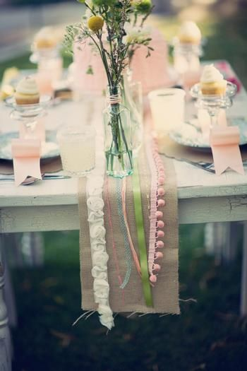 funky ribbons on this burlap table runner make it a little more playful