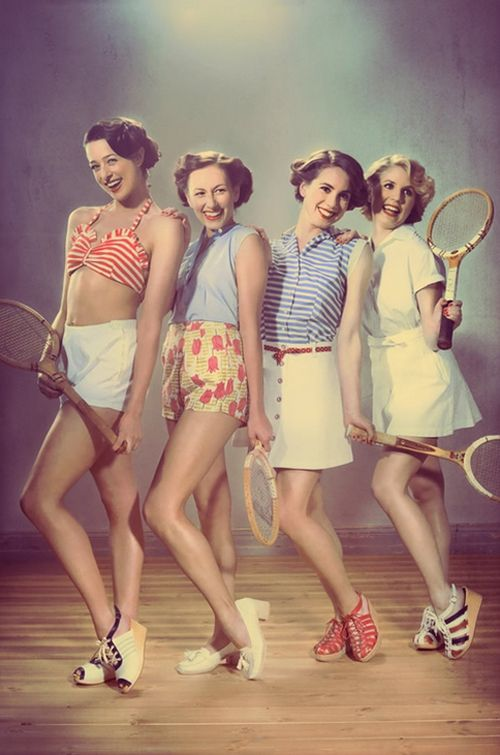 i love the outfit of the girl second from the right. love the blue striped top, red polka dot belt, white skirt, and red shoes. <3