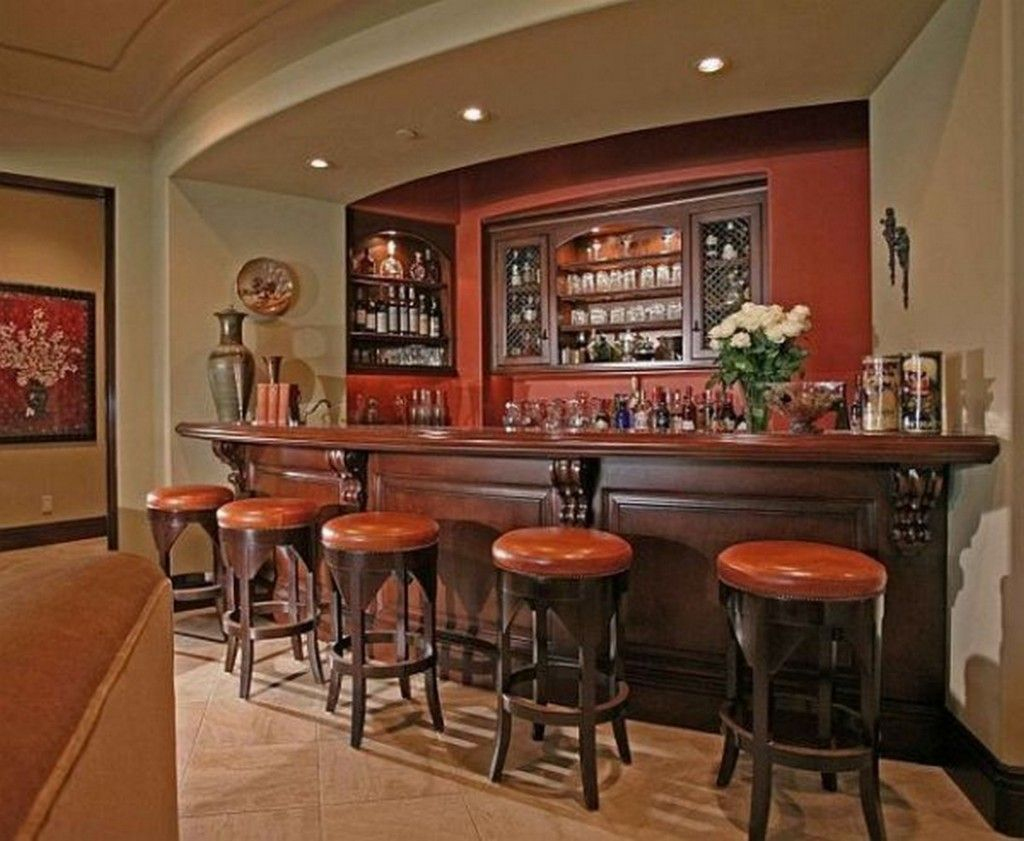 classic style home bar with dark wooden bar table and round leather