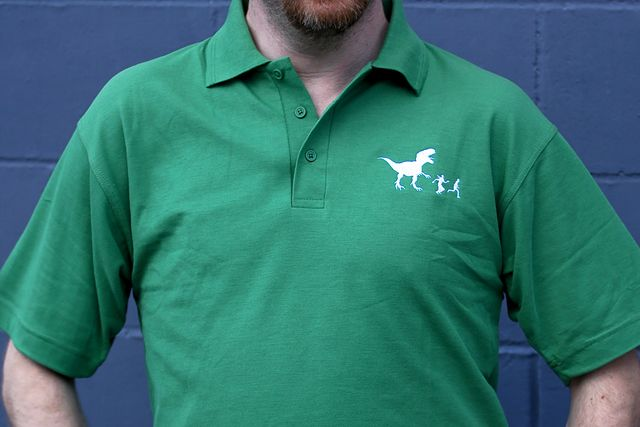 Run Humans, A Polo Shirt With a Dinosaur Chasing Two Humans