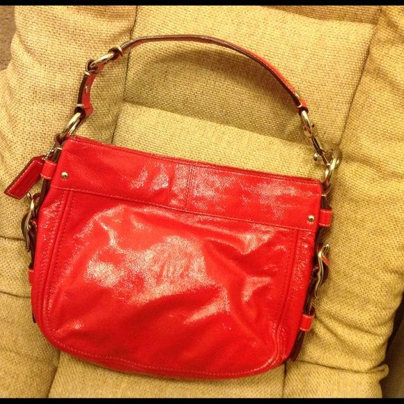 Sold locally Coach red patent handbag It's adorable!! 100% Authentic Coach Patent Red handbag  Details: Beautiful COACH. 100% authentic.  Super cute handbag! Great Condition, Has a few ink mark, please look the pictures Coach Bags