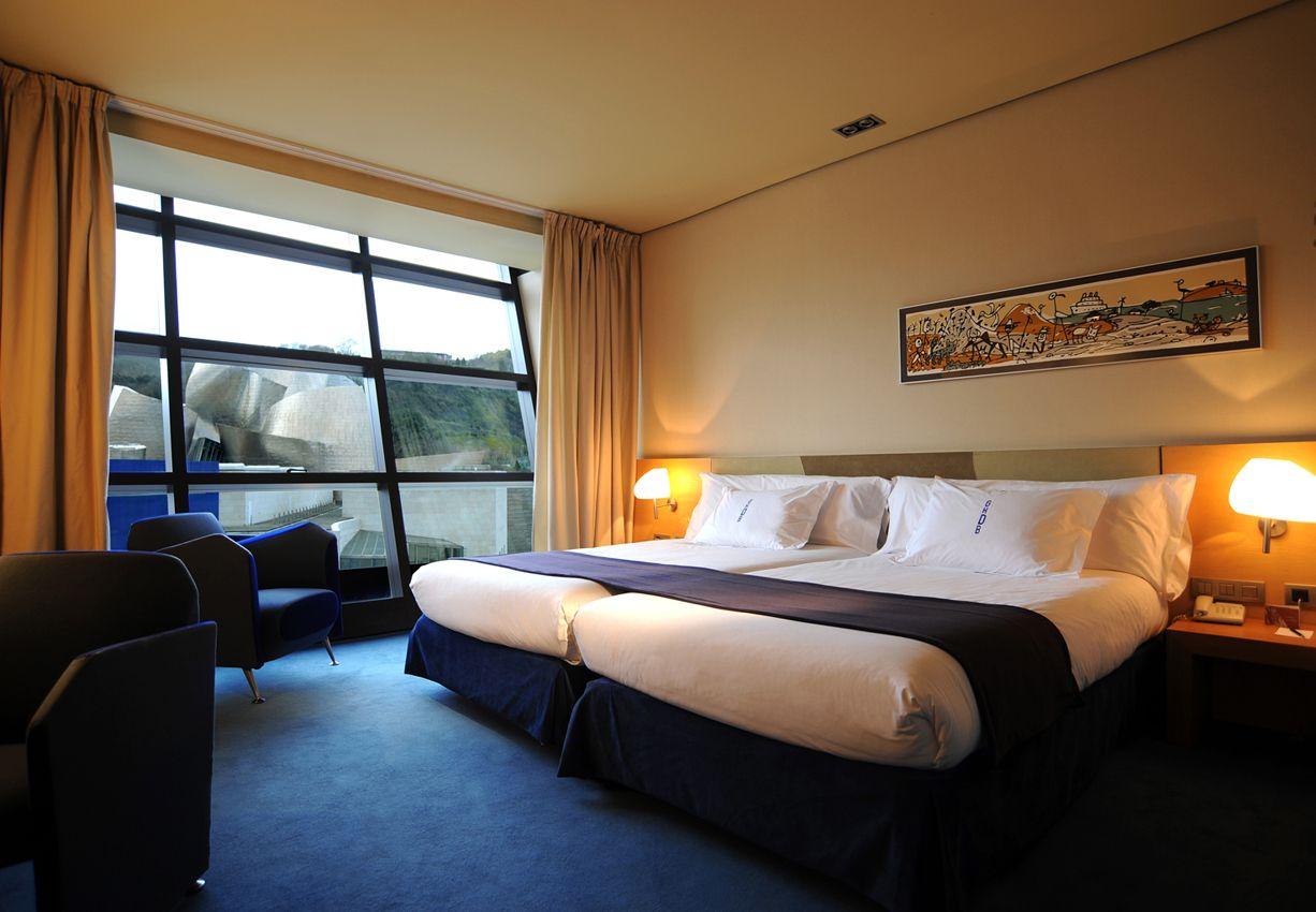Le proponemos una experiencia inolvidable: disfrute de las mejores vistas al Museo Guggenheim desde estas habitaciones extraordinariamente amplias, equipadas con los mejores materiales para contribuir a su descanso. http://www.hoteles-silken.com/hoteles/gran-hotel-domine-bilbao/habitaciones/