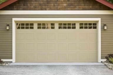 Replacing Your Garage Door We Answer Your Top Cost Concerns Garage Door Cost Double Garage Door Garage Door Design