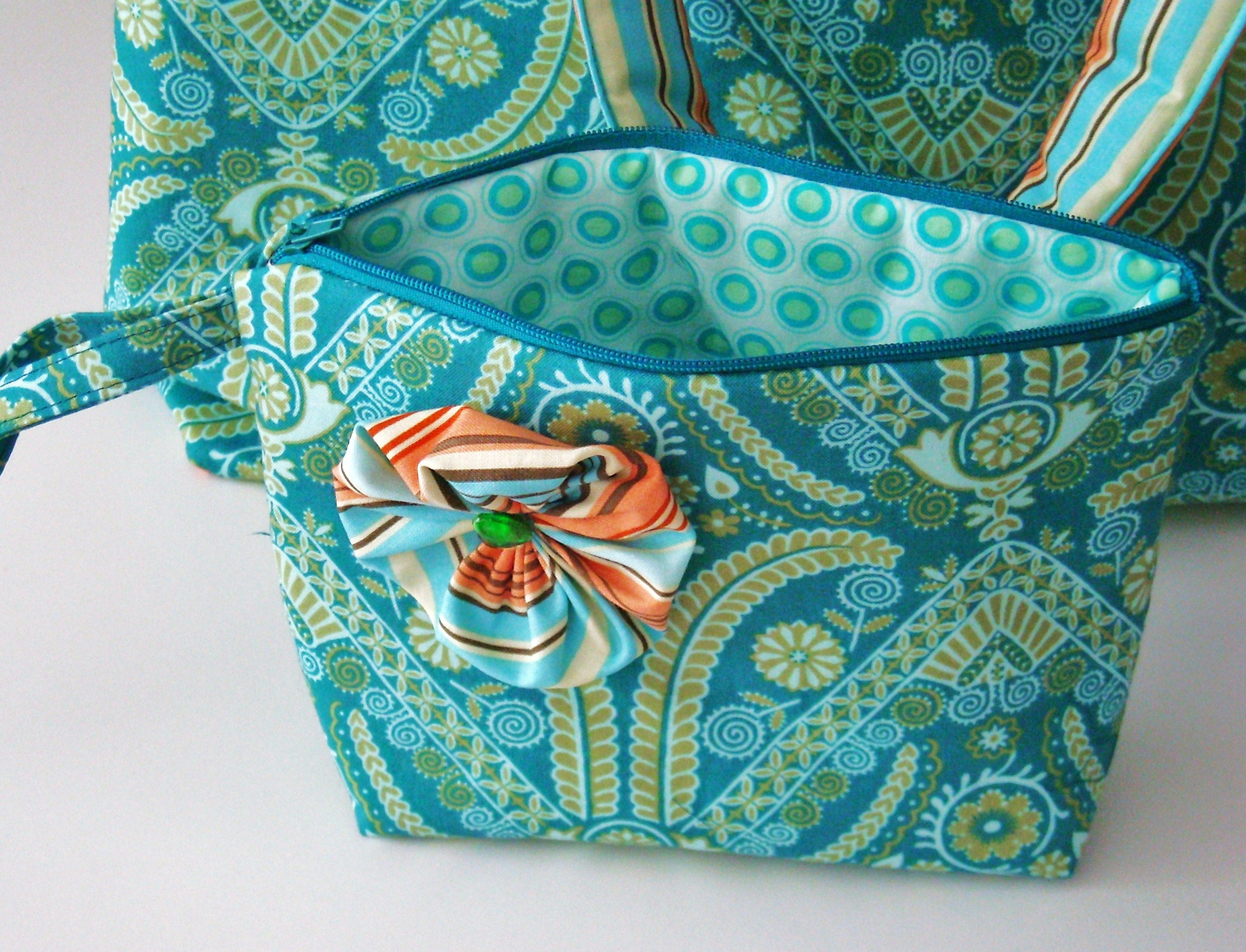 Cosmetic bag. USA Designer Fabric. Selfmade fabric flower