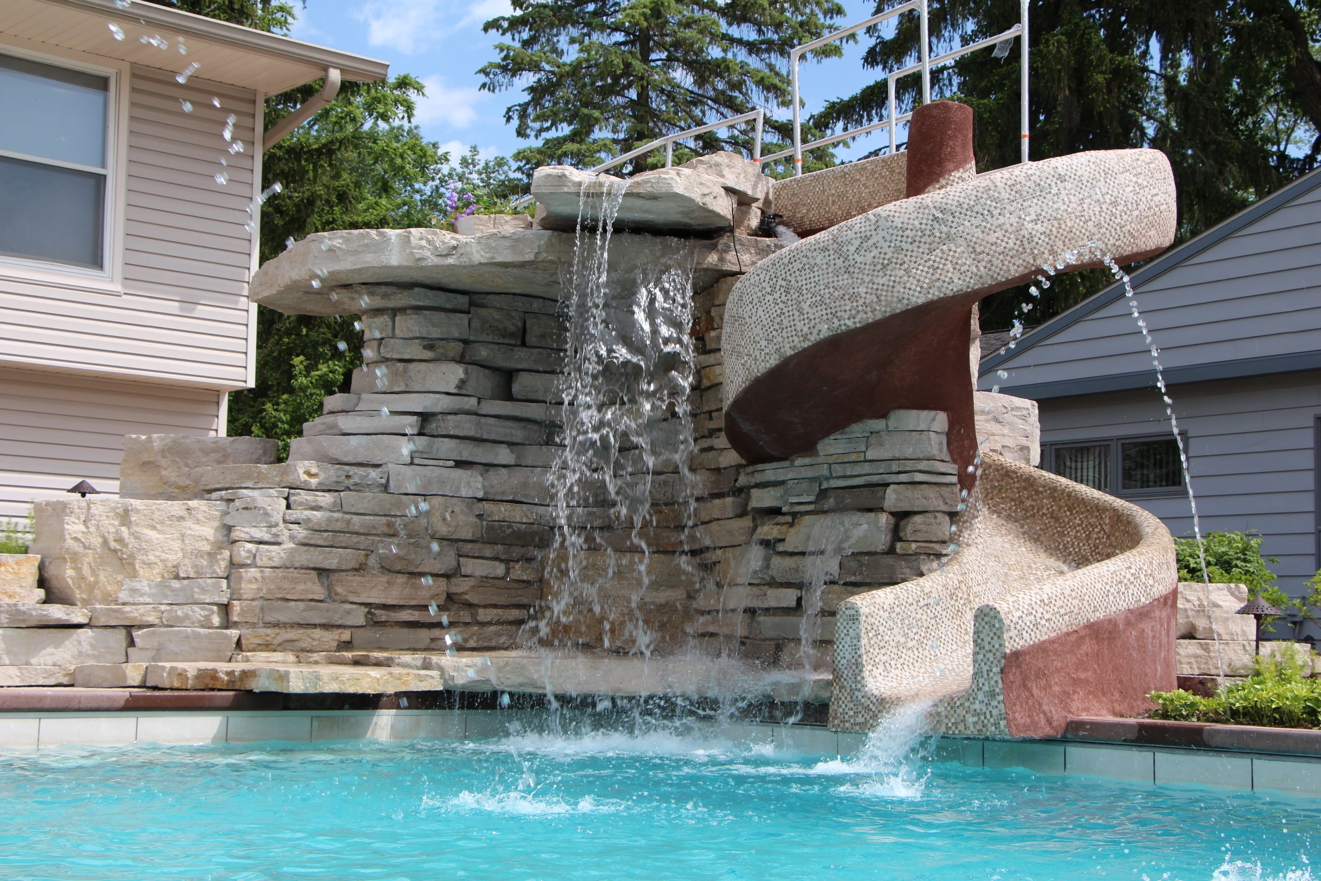 custom waterfall and slide quantus pools quantuspoolscom 847 907 4995