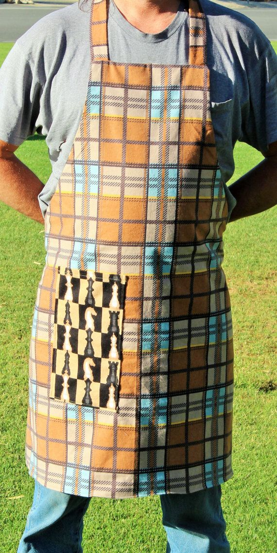 This apron is a reversible apron with chess pieces on one side and lights brown colors plaid on the other side.