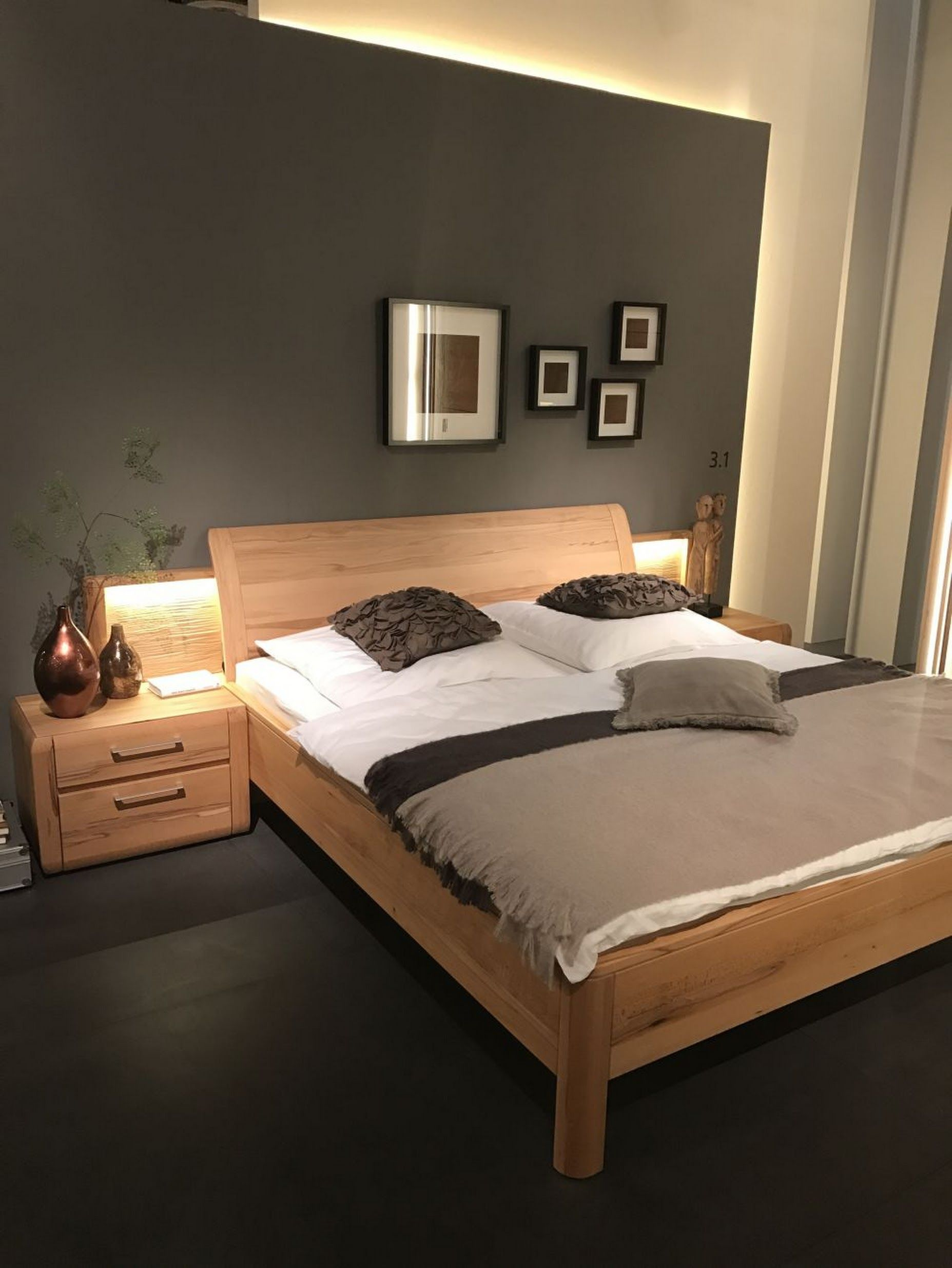 Wood bed with LED lighting behind
