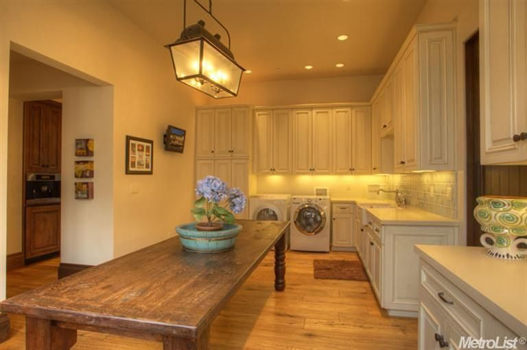 My dream laundry room..love the huge farm table to fold....much better than my dining room table