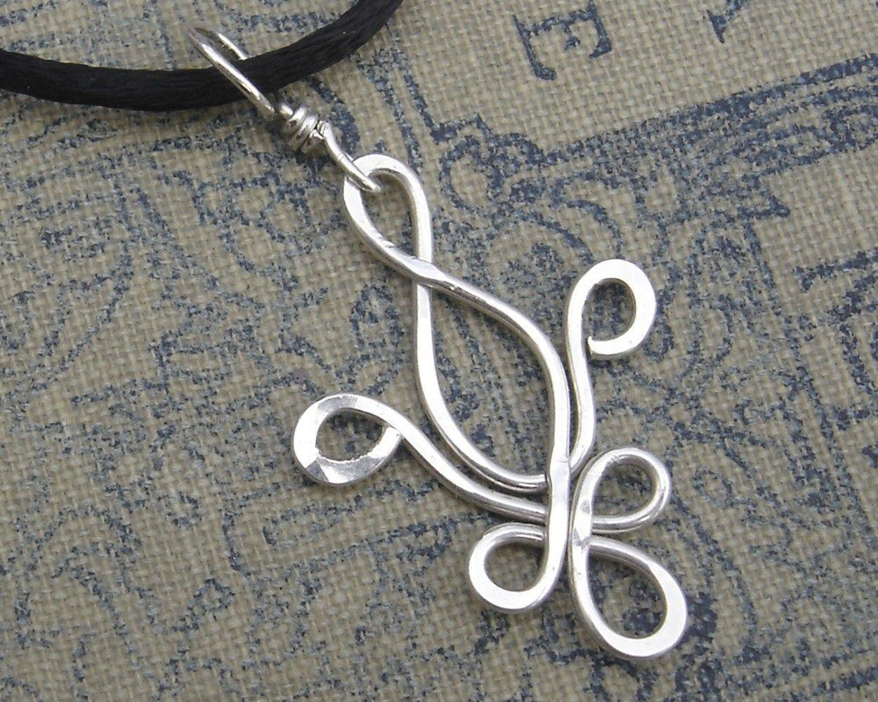 Type 2 necklace, silver, interconnected, tear shapes  Fleur De Lis Sterling Silver Pendant. $16.50, via Etsy.