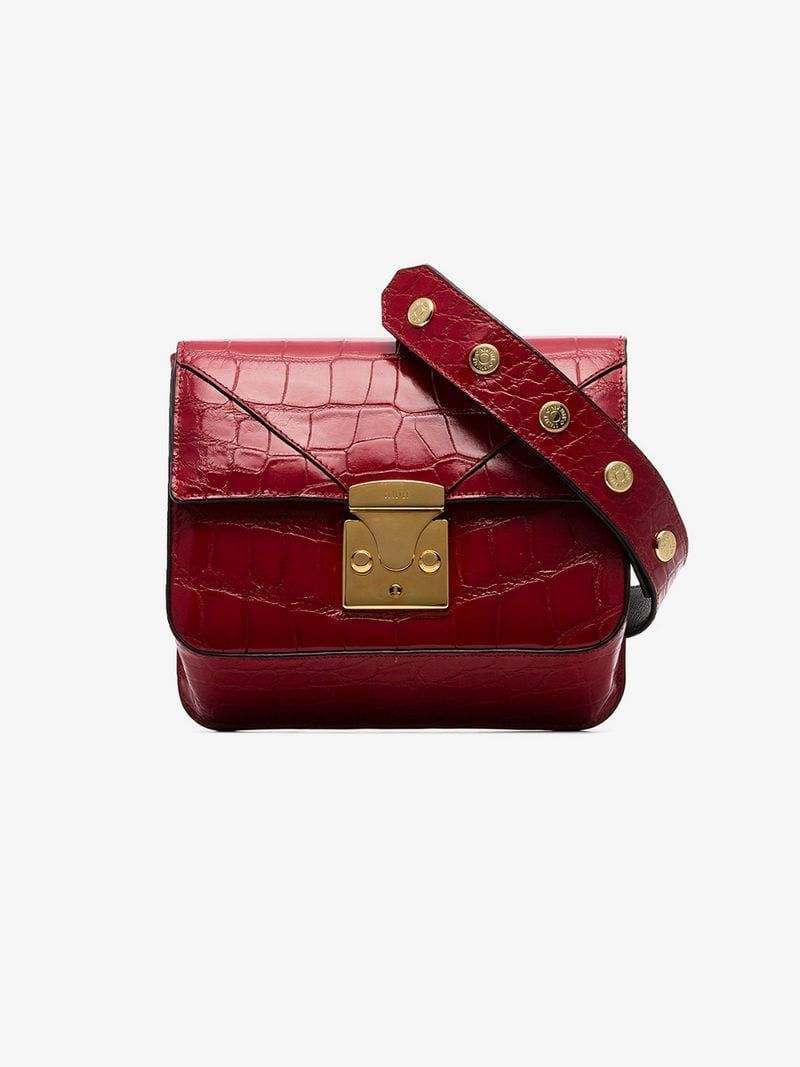 e389ecb91aa STALVEY | Red Alligator Belt Bag | $18,052.18 | This red Stalvey Alligator belt  bag is crafted in Italy from alligator skin in a square silhouette with ...