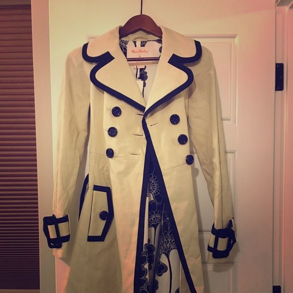 Kate Spade trench coat This is a tan trench with black pipping. It has a floral black and white lining. It's never been worn. kate spade Jackets & Coats Trench Coats