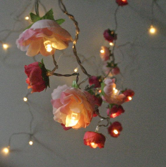 A pretty mix of roses in embers red, shocking pink and old fashioned pink with warm white LED lights. The lights are battery powered LEDs which makes