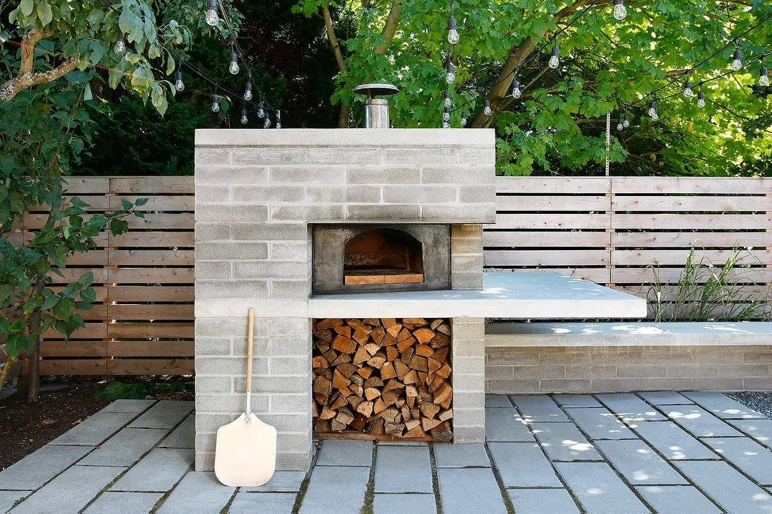 modern pizza oven w/ overhang work/prep/serving area | patio-porch