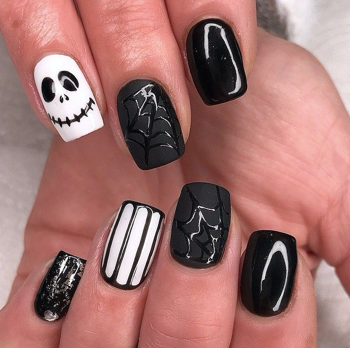"""Scratch Magazine 💅's Instagram profile post: """"We're counting down to Halloween🎃👻 🕸Check out the gallery of nail design inspo at scratchmagazine.co.uk! Nails by @_by_shelley 🖤🤍"""""""