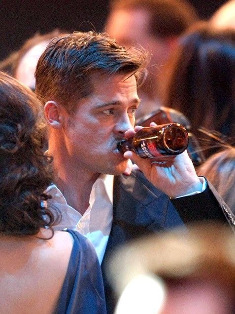 There's nothing like a cold beer to calm the nerves. Brad Pitt enjoys a Bud Light during the 2009 SAG Awards, where he was nominated for best actor for his role in The Curious Case of Benjamin Button. He lost out to Sean Penn -- but it looks like he still had a good time!