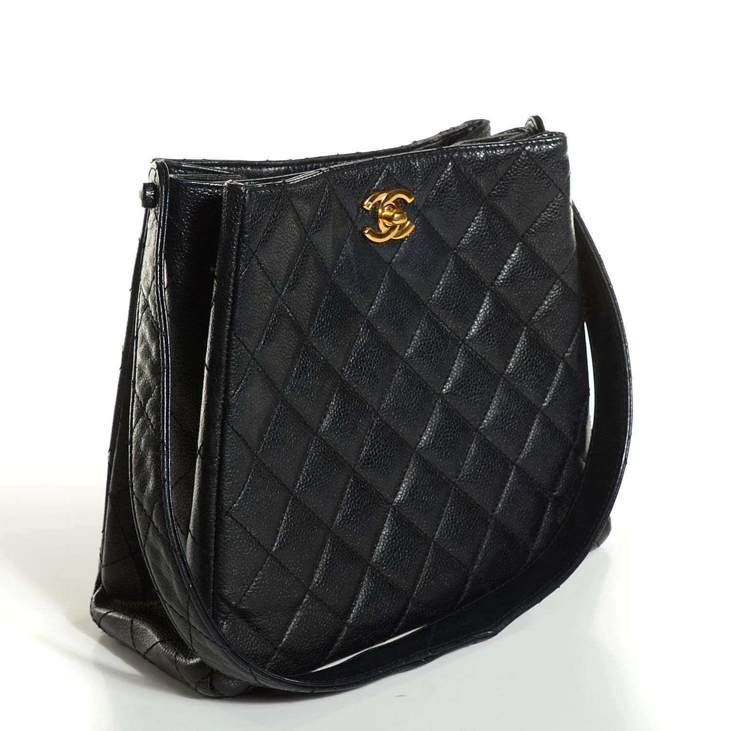 This is an authentic CHANEL Vintage Caviar Quilted CC Shoulder Bag in Black.  This stylish shoulder bag is crafted of fine diamond quilted caviar leather.  The bag features a singleshoulder strap and an upper gold Chanel CC Mademoiselle turn lock on each side.  This opens the top to a spacious partitioned leather interior with a zipper and patchpocket.  This is a marvelous shoulder bag, ideal for day and evening wear, from Chanel!