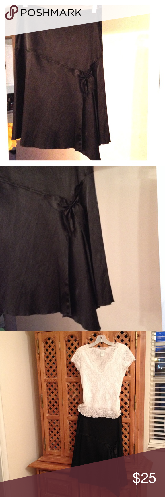 NORDSTROM BLACK FAUX SATIN SKIRT. Nordstrom asymmetrical black faux satin skirt. Photos do not capture how stunning the skirt is. Nicely detailed with black flat bow and interesting lines. Zips in back. Material is 69% Acetate, 26% Nylon and 5% Spandex. Designed by Ashley. Size S. Worn twice. Fabulous with a dressy white top and black heels! Skirts Asymmetrical