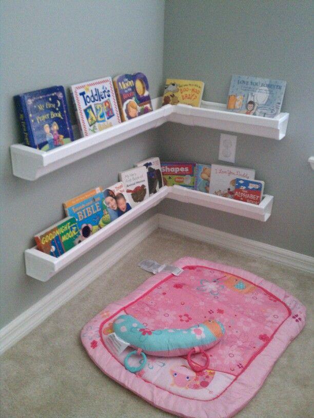 Kids Bedroom Reading Corner diy bookshelves made from vinyl rain gutters purchased at home