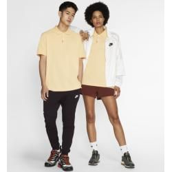 Photo of The Nike Polo Poloshirt in schmaler Passform (Unisex) – Gold Nike
