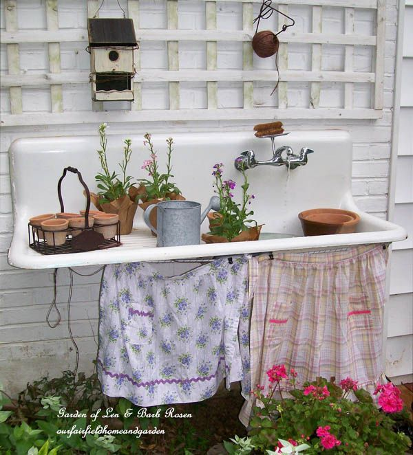 Have a stainless sink and the old trellis for the wall.   http://ourfairfieldhomeandgarden.com/