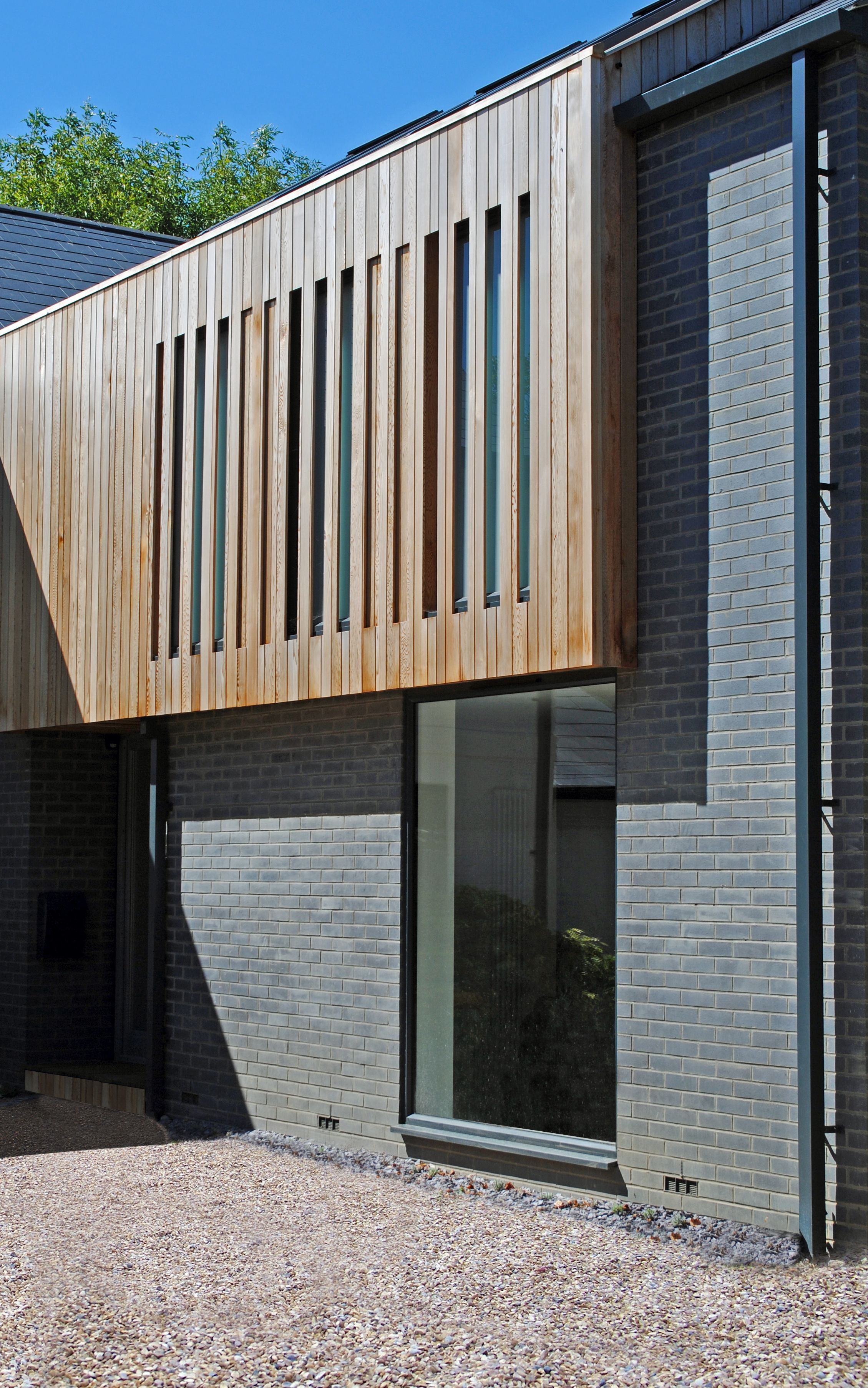 Timber cladding and grey brick extension by la hally - Brick and wood house ...