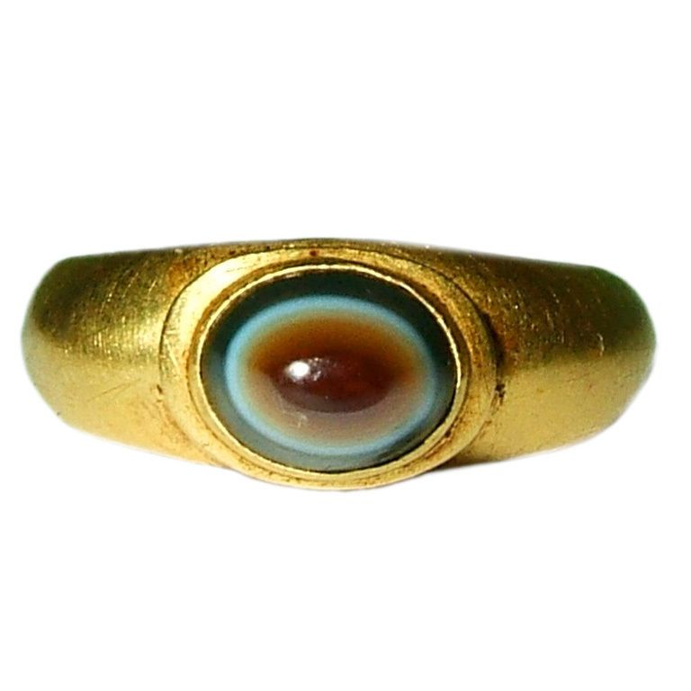 This is an ancient ring from the time of the Roman empire, in the 2nd-3rd century. It's made of gold, with color banded sardonyx.