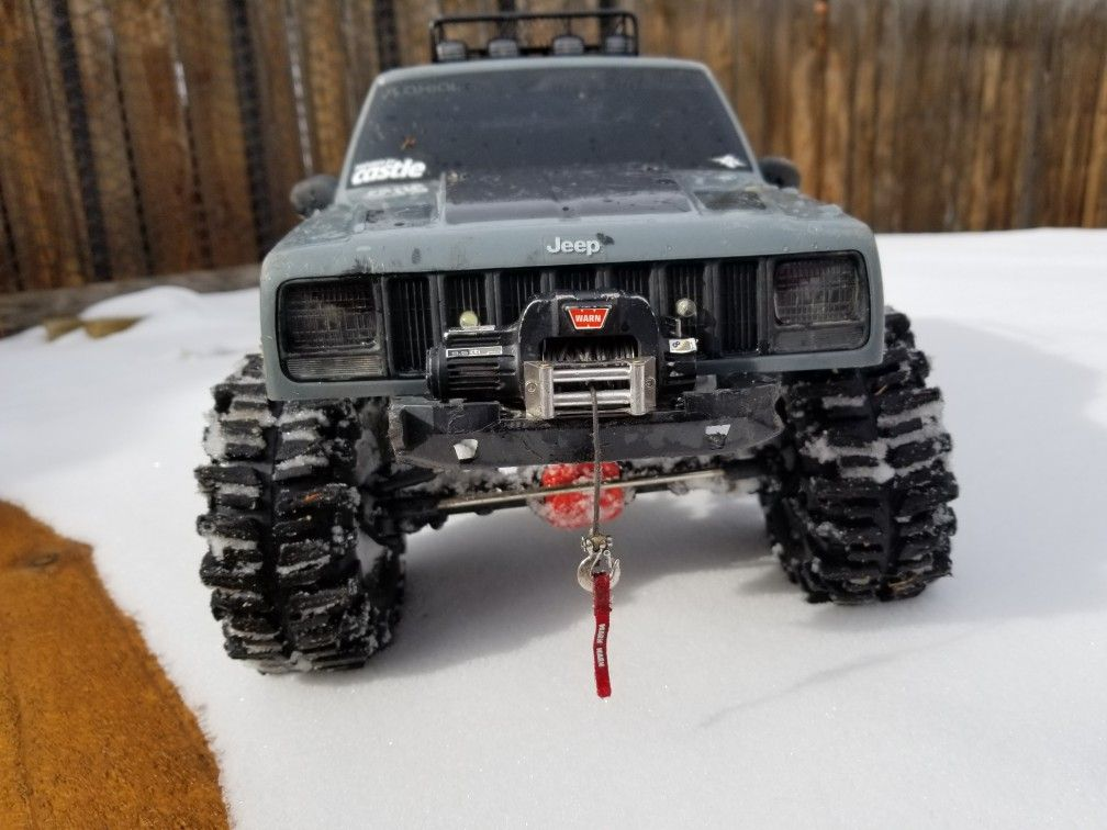 Axcial scx10 ii RC Jeep Cherokee with Warn winch and 2 2 mud