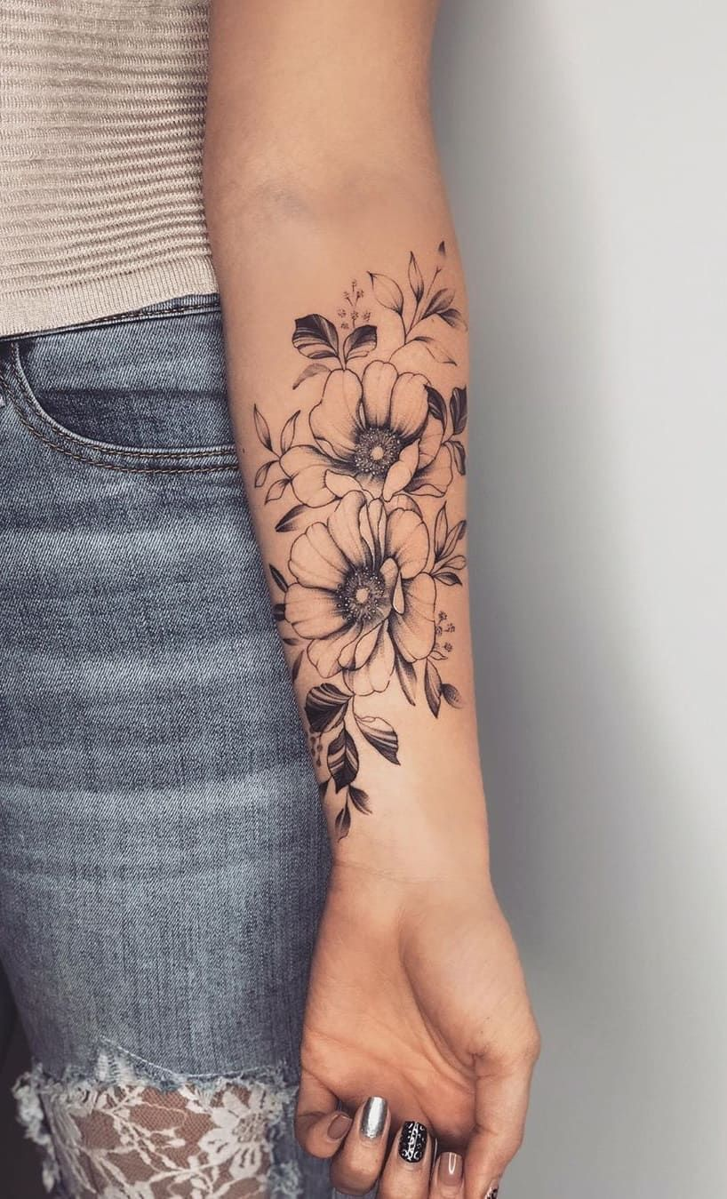 Photo of tattoo female flowers gentle arm
