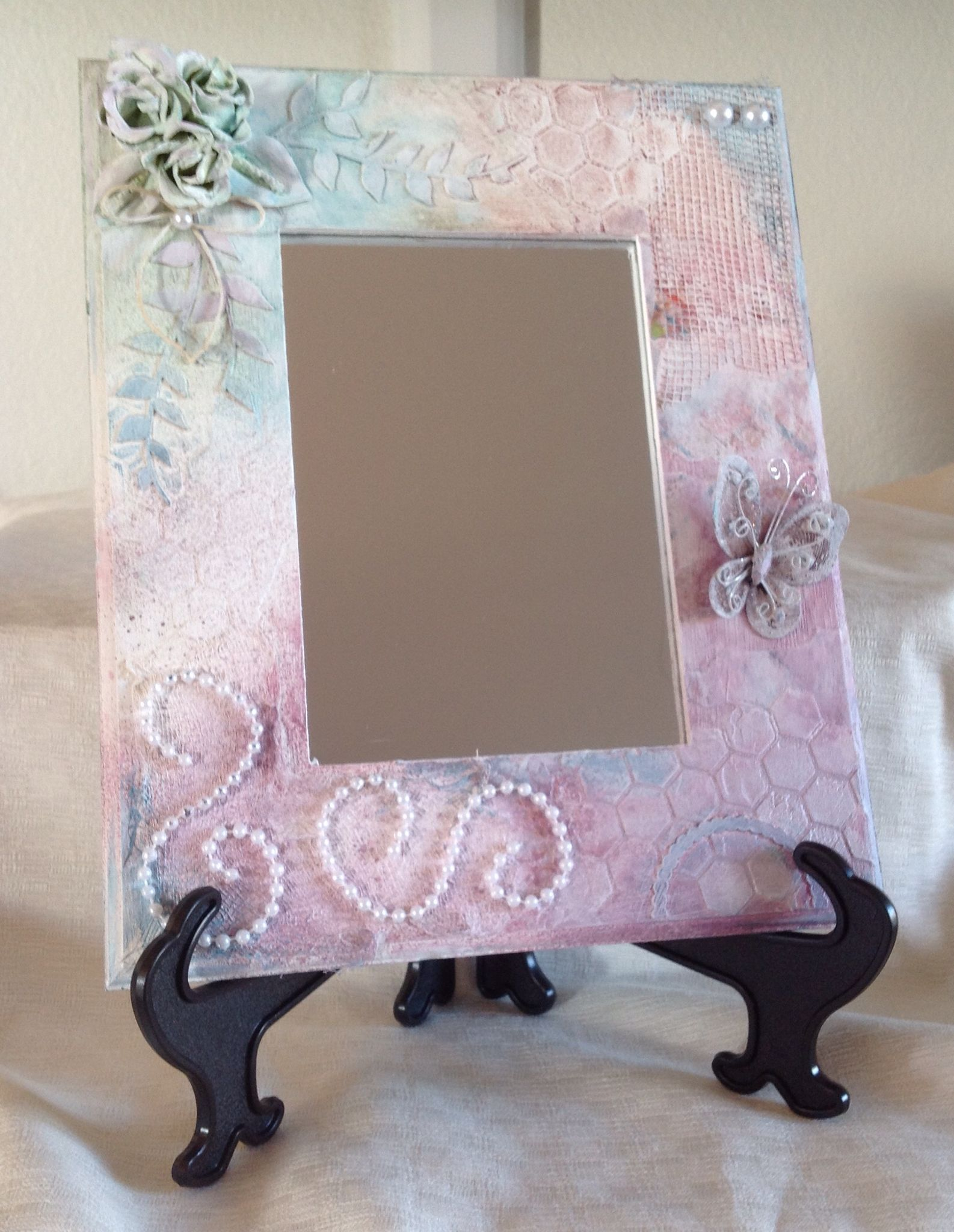 Vintage style mirror with easel.