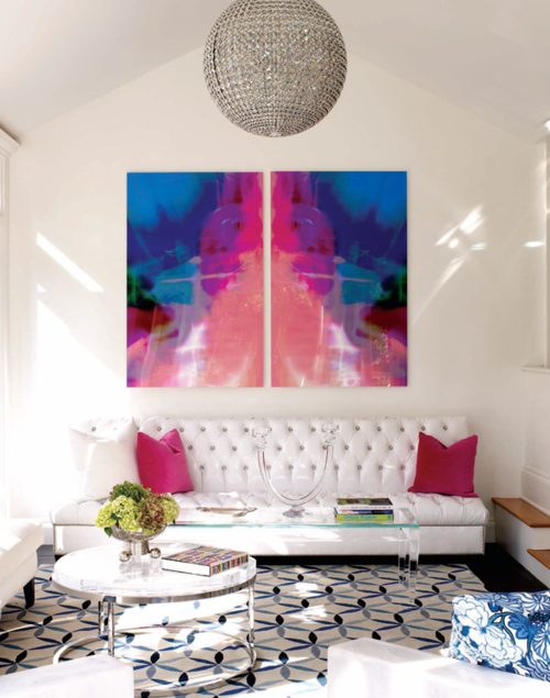 Love the white walls and colorful art, with pops of color in the ...