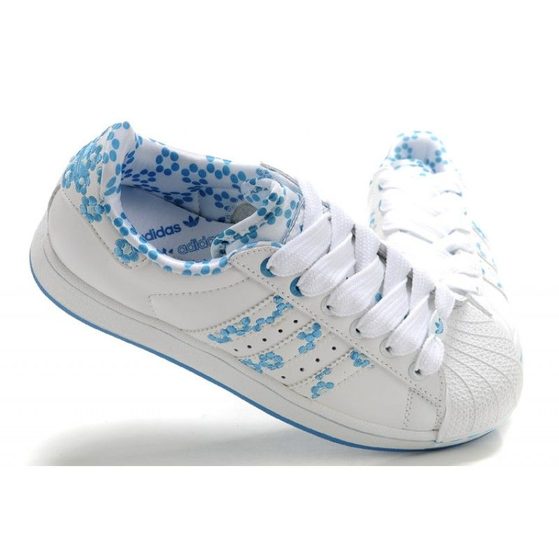 With this shoe, a white upper is broken up by a floral pattern featuring  blue flowers on the stripes and ankle. The blue sole and lace rings also  add ...