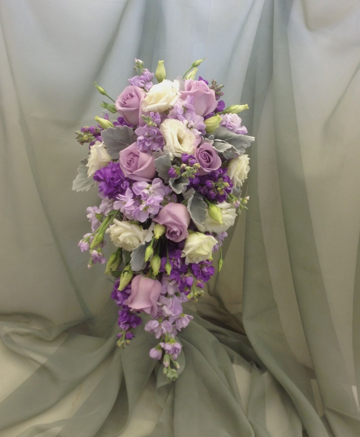 Lavender White And Plum Cascading Bridal Bouquet By Nancy At Belton Hyvee Wedding Flower Pricing Colorful Bridal Bouquet Silk Flower Bridal Bouquet