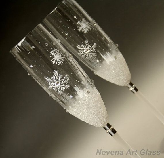 A set of 2 Hand Painted romantic, winter wedding champagne glasses. Silver snowflakes, silver shine, pearl effects, snow effect. Decorated with Clear Swarovski Crystals. Like Ice Queen Winter have painted with her magical brush.... The photographs could not express the full glamour, the ice shine and charm of this champagne glasses,so you have to see it in person.  Free hand painting, Author design, one of a kind glasses.  Height 24.5 cm / 12 in 21cl  Gift pack !  Ready to ship!  Only ha...