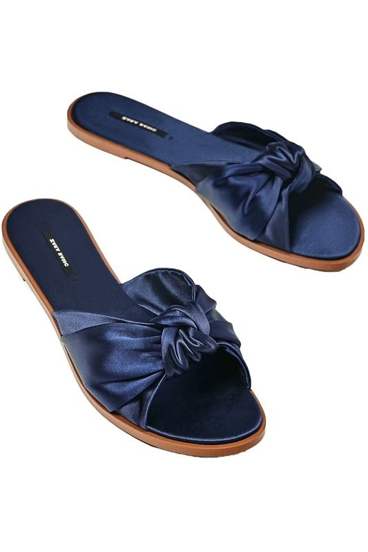 ca4c1681d394 Every fashion girl owns these navy satin knot tied slides from Zara
