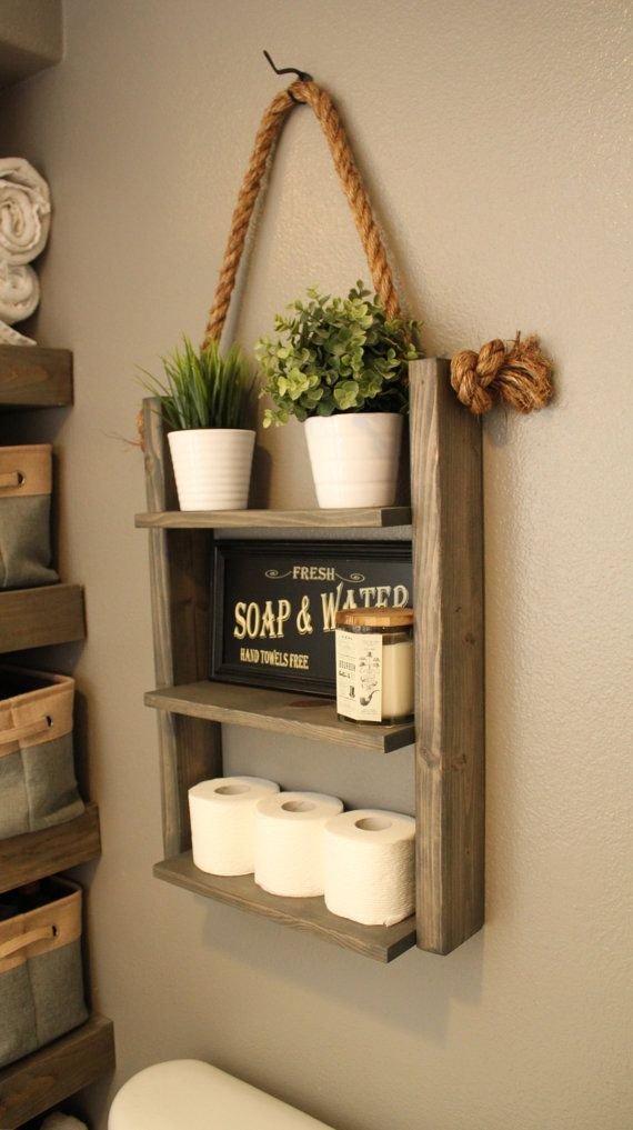Hanging Wood and Rope Ladder Shelf The Hanging Rope   Ladder Shelf will  make a statement in any home with its rustic yet modern flare and can be  utilized ... 5addea769