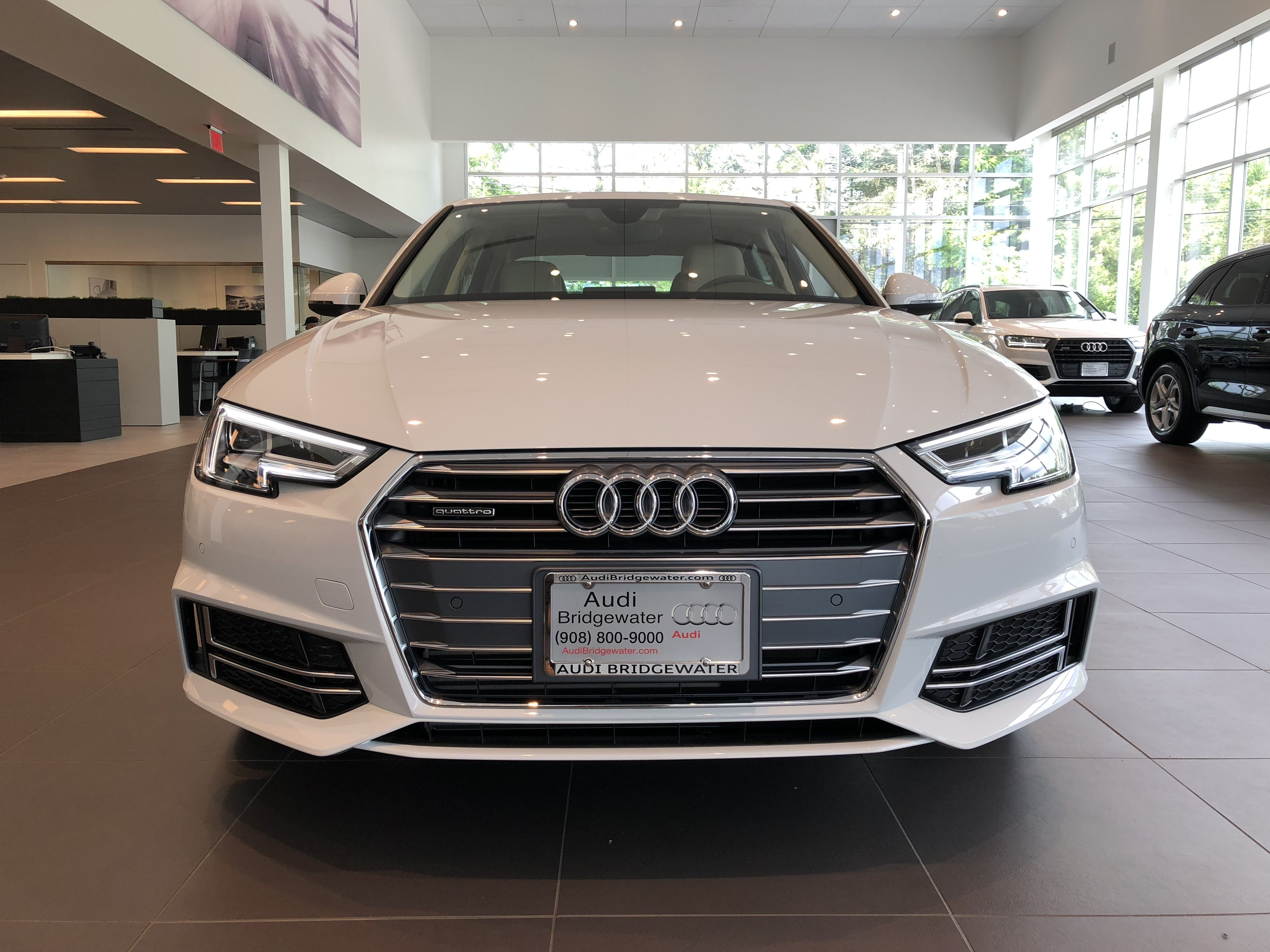 Front End View Of An Ibis White 2018 Audi A4 With Grill Logo And