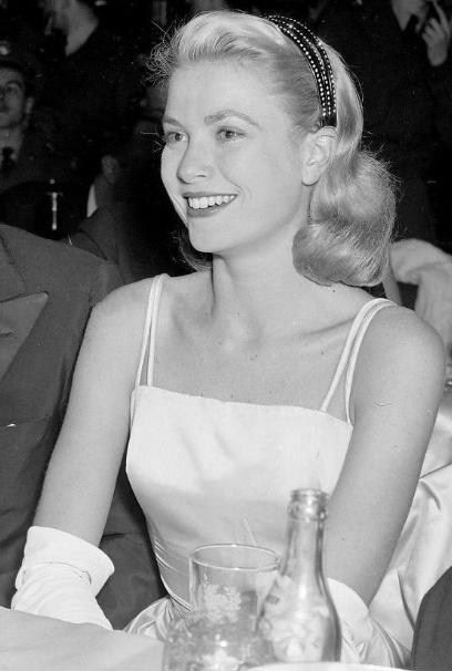 Grace Kelly in the same Dior dress she wore when receiving her Academy Award.