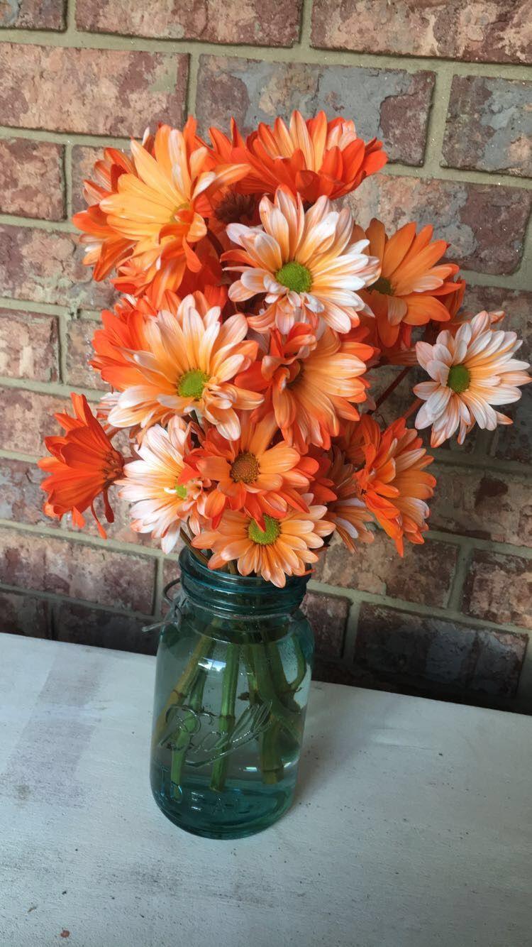 Diy wedding centerpieces using old mason jars and orange Daisies