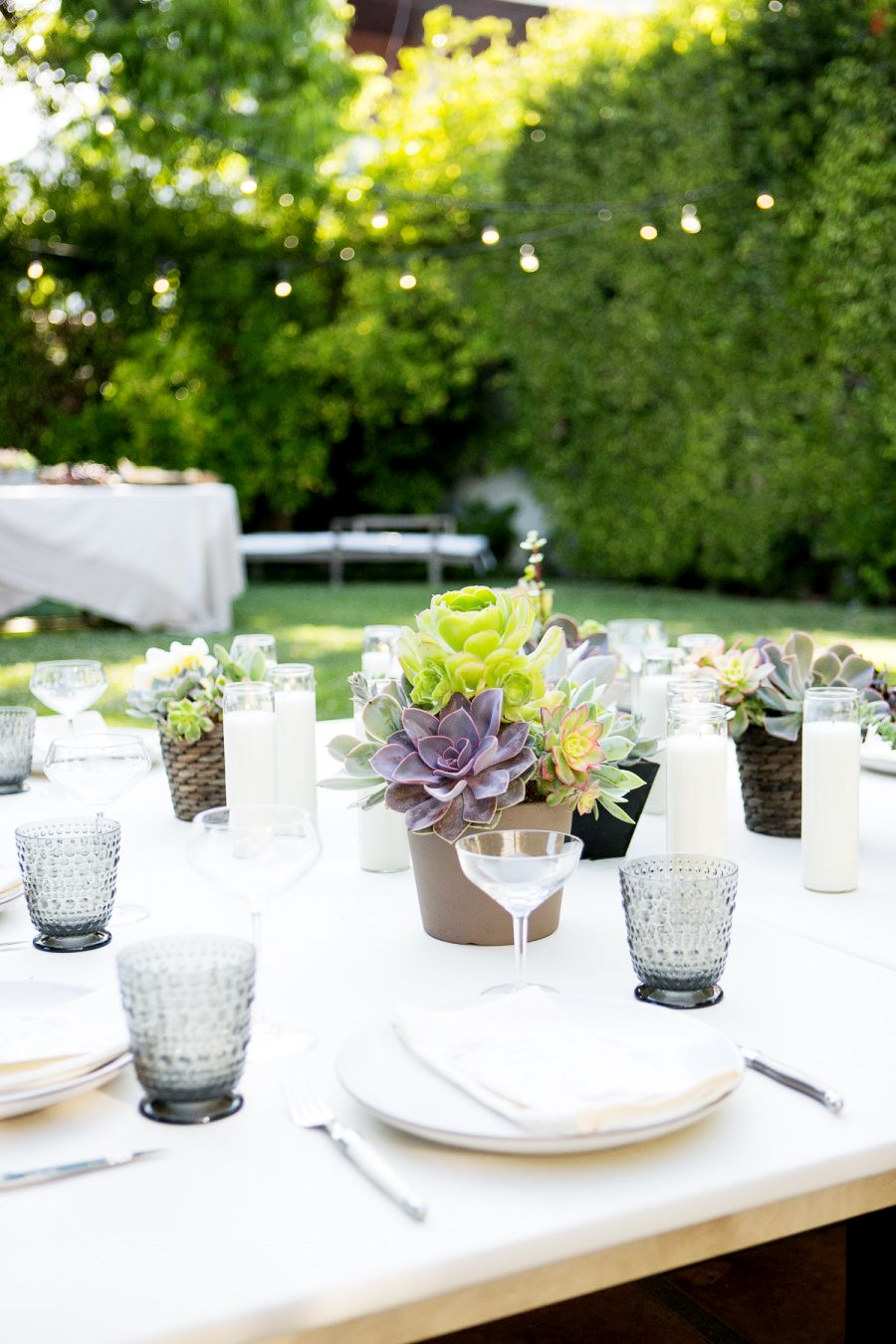 inside a boho backyard dinner party backyard table scapes and