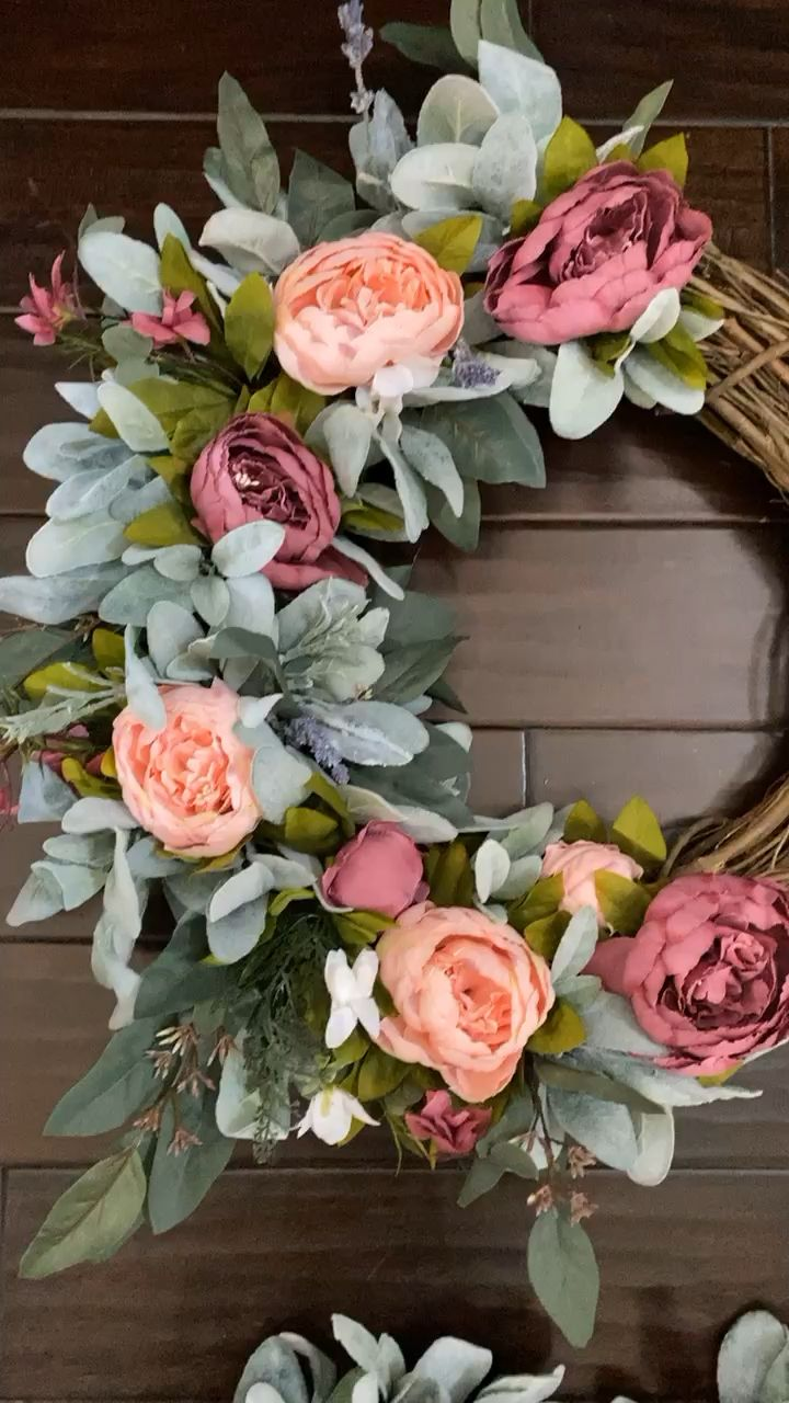Our mixed peony wreaths are spring on your door! Bursting with greenery and various shades of pink peonies this wreath is a best seller and can be up until fall