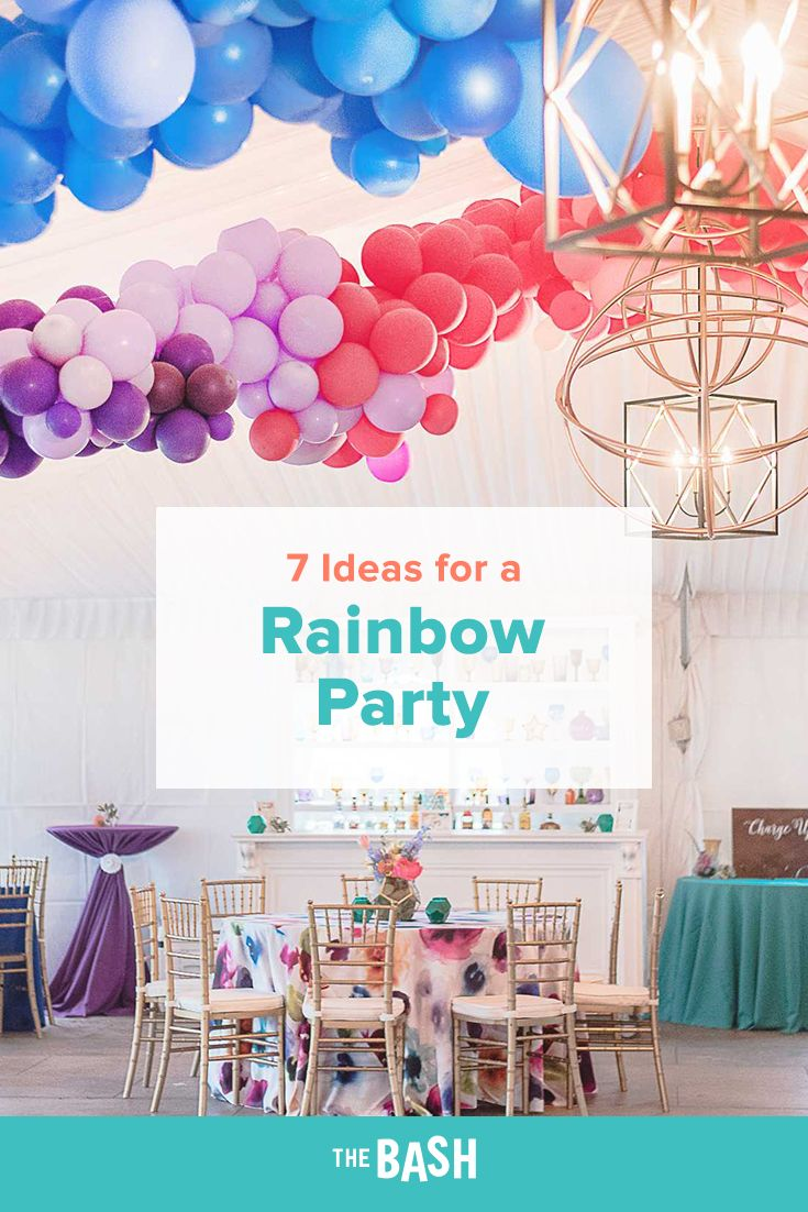 This rainbow balloon decor is so amazing! It's a fun way to throw some color into an all-white venue. #balloons #rainbow #partydecor #partydecorations #partytheme #partyideas