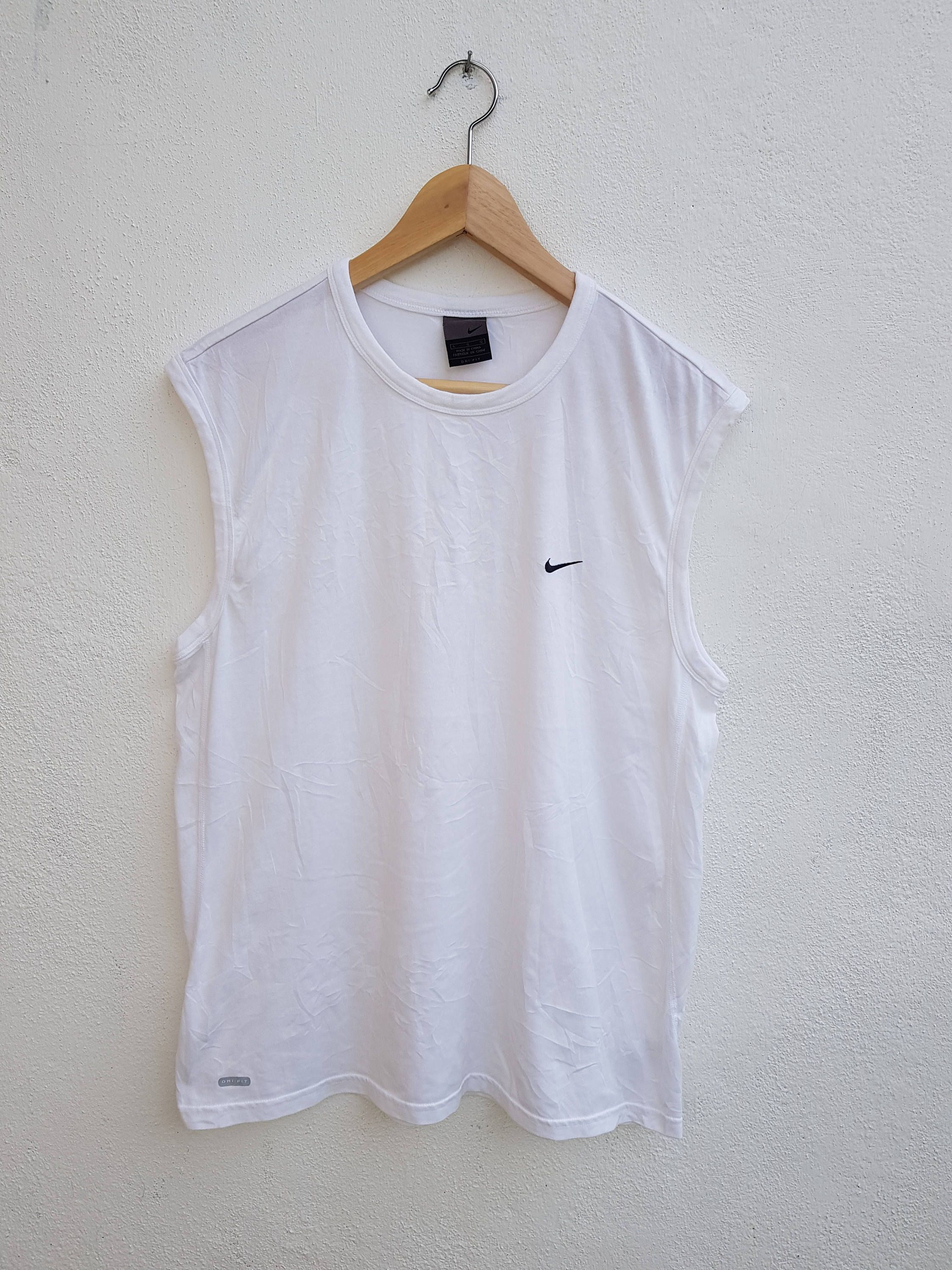 ae524299 Vintage 90s Nike Swoosh Embroidered Small Logo Basic Sportswear Tanks Tops  Shirt Size L by BubaGumpBudu on Etsy