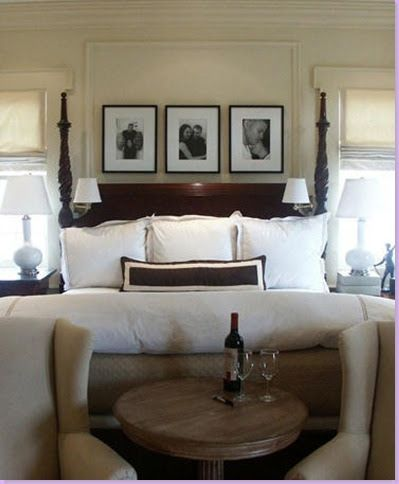 dark wood & white - bedroom- love the 3 frames between the windows ...