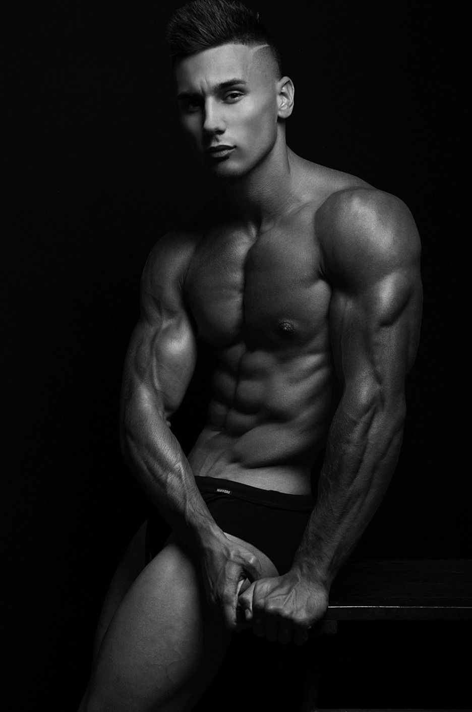 and Hunks posing flexing muscle