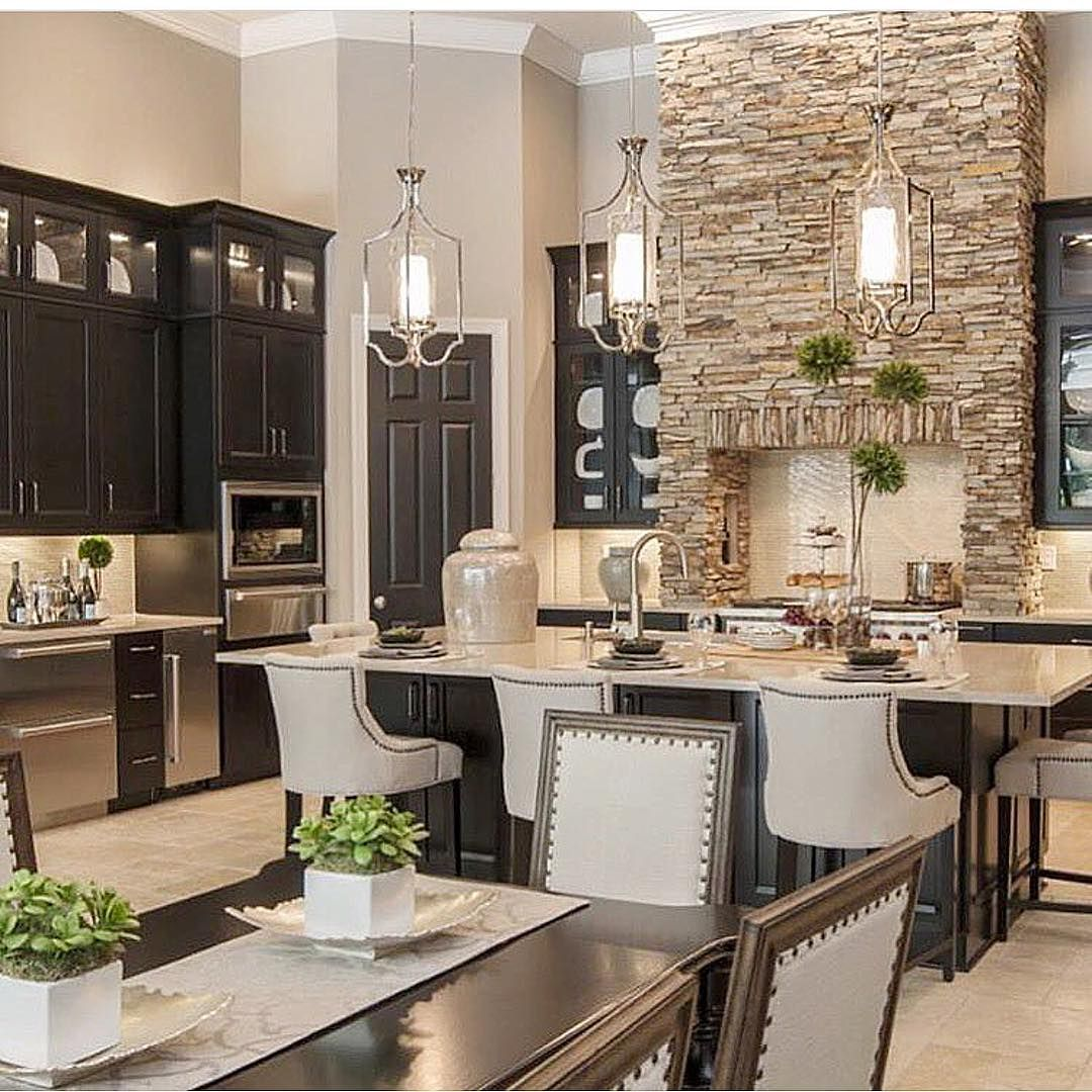 So warm and cozy love the statement stone work in the kitchen by