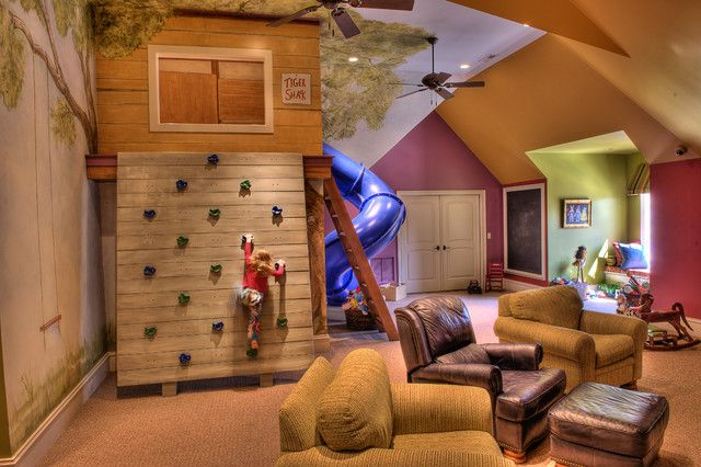 its an indoor treehouse a rock wall a kids play room a family room talk about a room pulling double duty