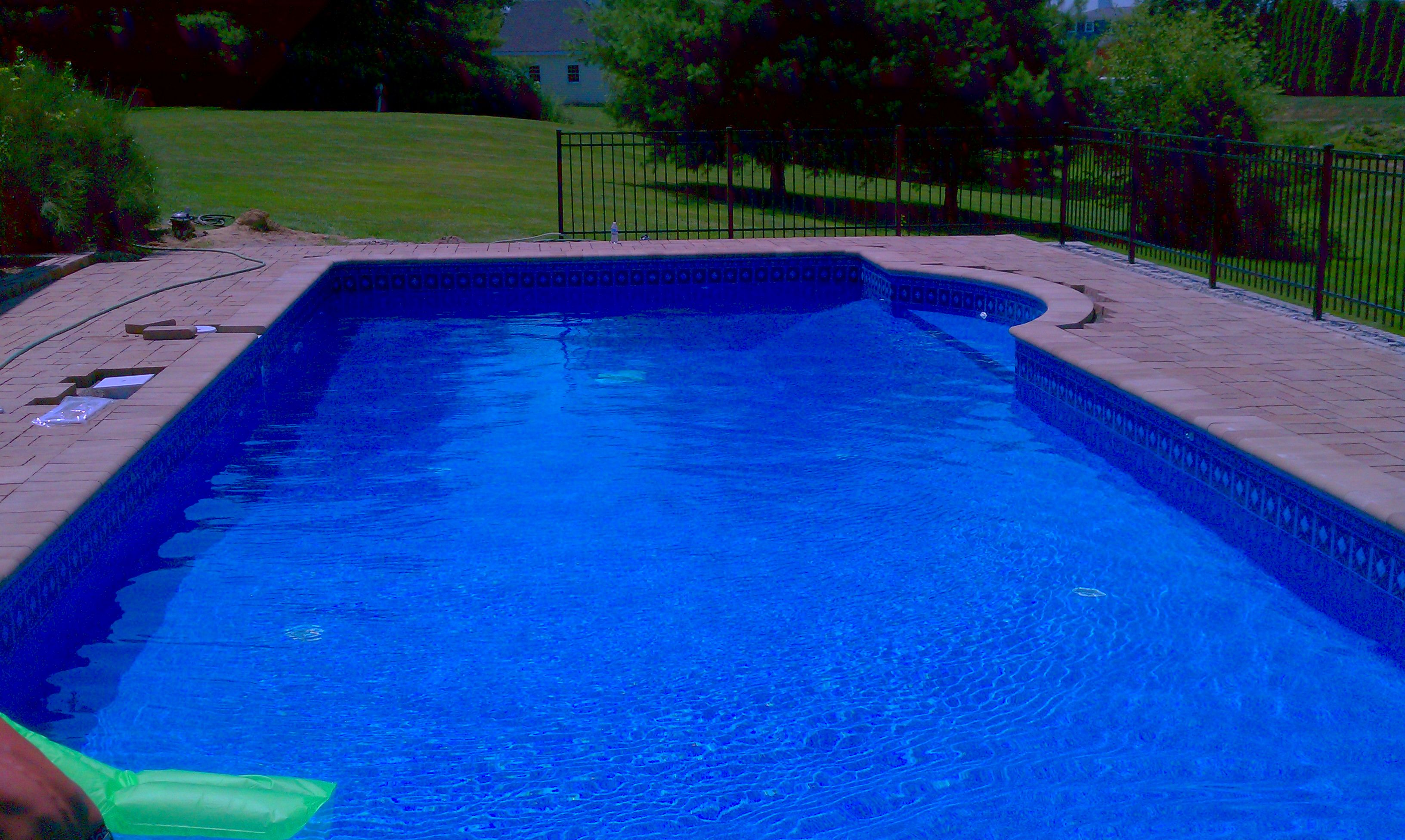 Deep Backyard Pool rectangle pool with deep end swimout stone coping and techo-bloc