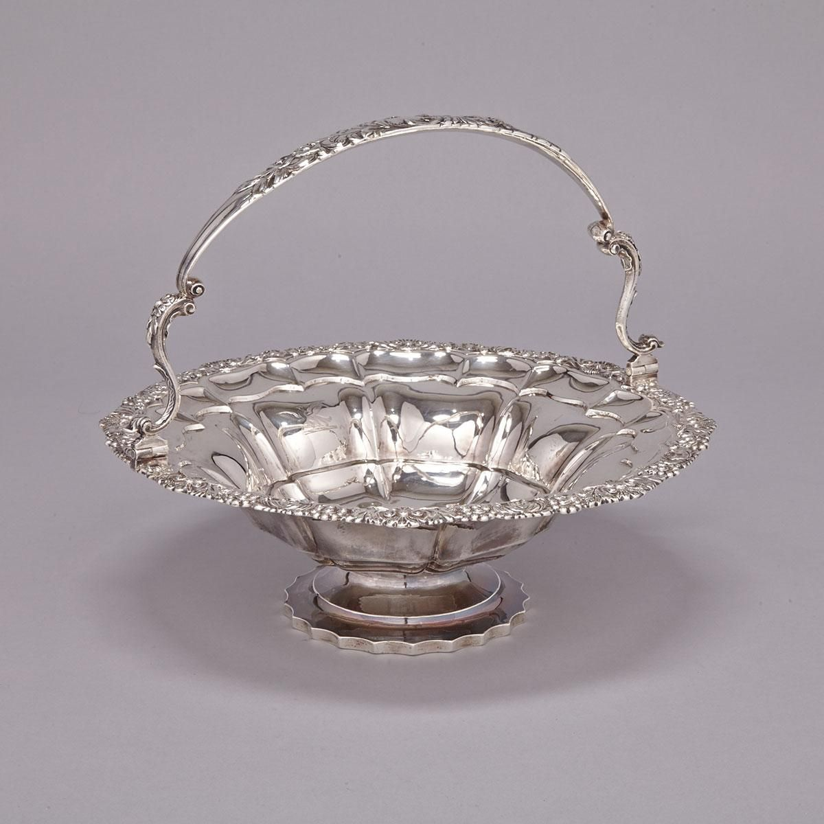William IV Silver Circular Cake Basket, Charles Thomas Fox, London, 1830 with moulded rim and swing handle, engraved with a crest and armorials, height 11.4""
